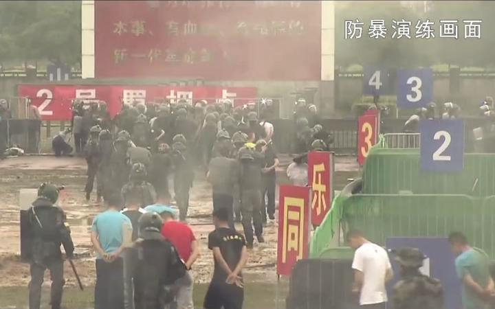 "This screengrab taken from undated handout three-minute promotional video received on August 1, 2019 from China's People's Liberation Army (PLA) Hong Kong Garrison shows ""protesters"" being detained by PLA soldiers during an ""anti-riot"" drill in Hong Kong."