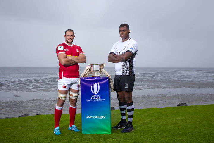 Canada's Tyler Ardron and Fiji's Leone Nakarawa pose with the World Rugby Pacific Nations Cup.