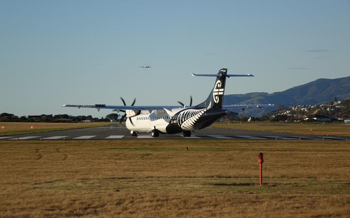 An Air New Zealand turboprop plane prepares for takeoff from Nelson Airport.