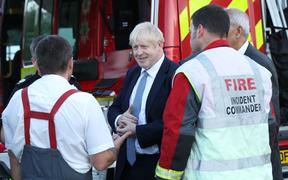 Prime Minister Boris Johnson meets emergency crews at Whaley Bridge Football Club in Derbyshire,