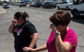Residents Erica Rios, 36, and Alma Rios, 61, cry outside a reunification center at MacArthur Elementary School, following a deadly mass shooting, in El Paso, Texas, on August 3, 2019.