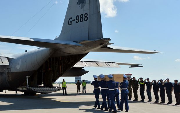 The first plane carrying bodies from Flight MH17 touched down at Eindhoven air base.
