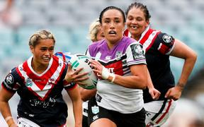 Krystal Rota playing for the Warriors against the Sydney Roosters in the NRL's women's premiership.