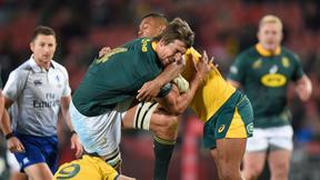 South Africas' Eben Etzebeth is tackled by Australia's Kurtley Beale during the 2019  Rugby Championship.