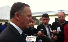 John Key speaking to reporters in Christchurch on Thursday.