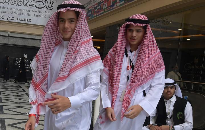Amir Mohamed Khan (R), 14, and Chouaib Milne, 16, are pictured at a hotel in Mecca on August 7, 2019, prior to the start of the annual Hajj pilgrimage  - Two hundred survivors and relatives of victims of March's massacres at two mosques in Christchurch,  are undertaking the hajj pilgrimage