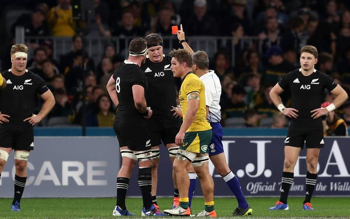 Scott Barrett of the All Blacks is sent off by referee, Jerome Garces