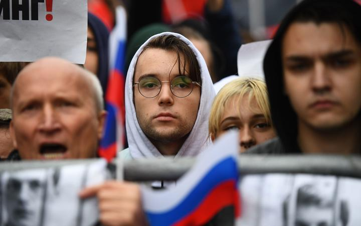 People attend a rally in support of the registration of independent candidates for the September's elections to the Moscow City Duma and against police brutality, in Moscow, Russia.