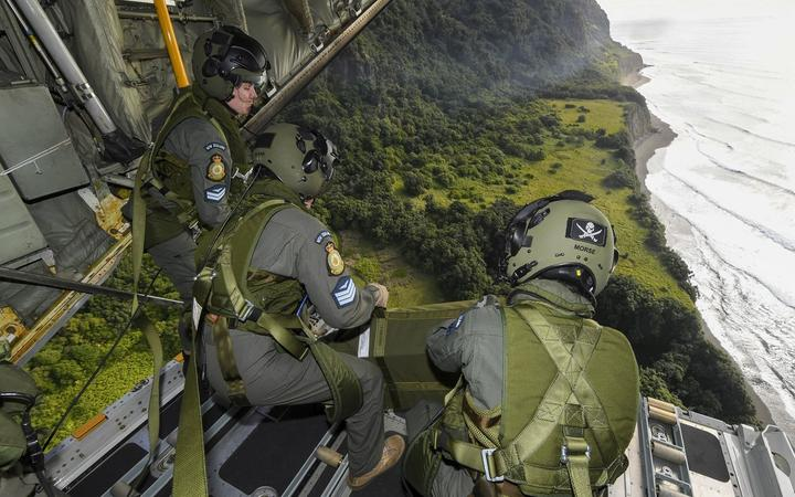 40 Sqn air drop supplies via parachute onto Raoul Island.