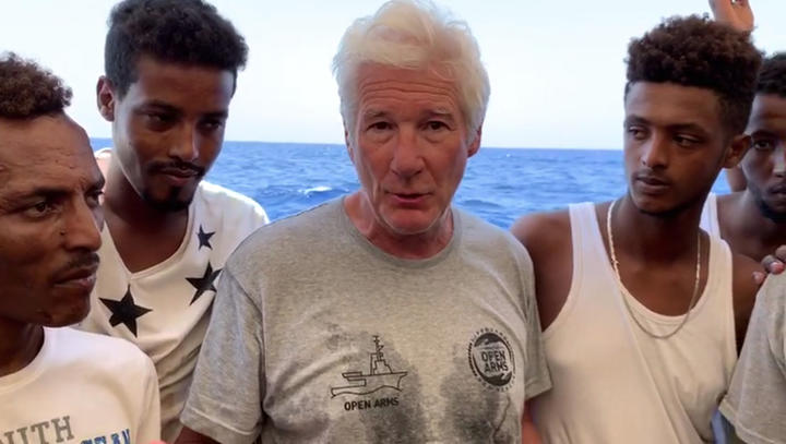 US actor Richard Gere on a Proactiva Open Arms boat transporting migrants rescued from the Mediterranean Sea.