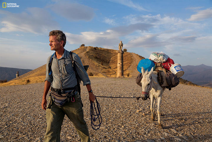National Geographic Fellow Paul Salopek leads his mule past a royal tomb in east Turkey during his decade-long Out of Eden Walk