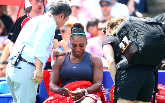 Serena Williams of the United States becomes upset after withdrawing from the final match against Bianca Andreescu of Canada due to a back injury at the Rogers Cup.
