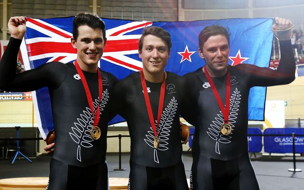 Sam Webster, Ethan Mitchell and Eddie Dawkins celebrate after winning gold in the Men's Team Sprint.