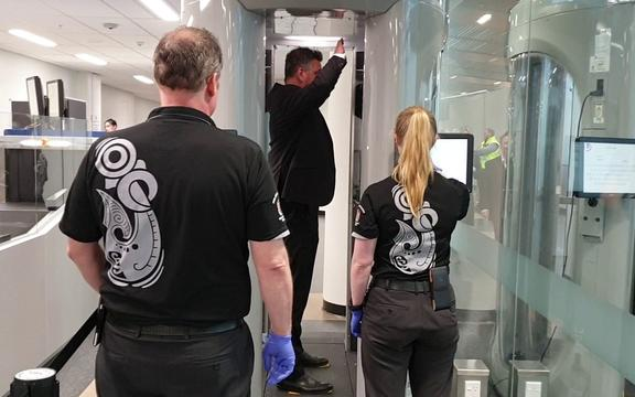 Dunedin Airport chief executive Richard Roberts testing out the new millimetre-wave technology body scanners at the airport.
