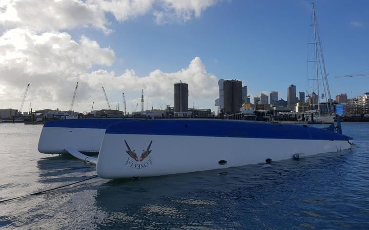 An overturned catamaran at Westhaven Marina on Tuesday after an overnight storm hit downtown Auckland.