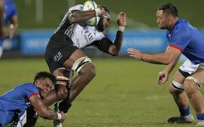 Fiji's Semi Kunatani is tackled in their 10-3 win over Samoa in the World Rugby Pacific Nations Cup 2019 at ANZ Stadium in Suva on 10 August.