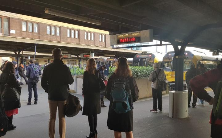 Commuters wait for trains at Wellington Railway Station after a power fault this morning.