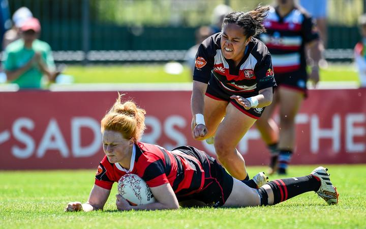 Grace Brooker of Canterbury scores a try