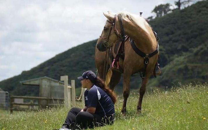 Black Ferns prop Aleisha-Pearl Nelson with one of her horses.