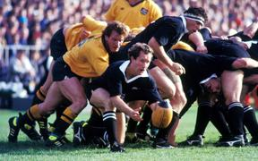 All Black halfback Bruce Deans clears the ball during a test against Australia at Eden Park in 1989.