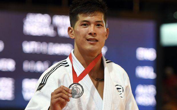 New Zealand's Adrian Leat who won the silver medal during his 73kg Judo Final against against England's Danny Williams. Commonwealth Games. Glasgow, July 2014.