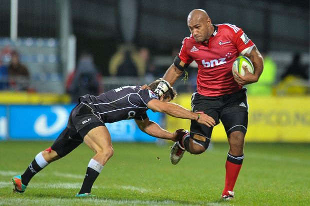 Nemani Nadolo fends off Paul Jordaan during the Crusaders' loss to the Sharks in May 2014