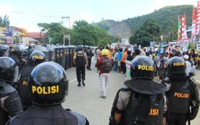 Police blockade the protest in Jayapura.