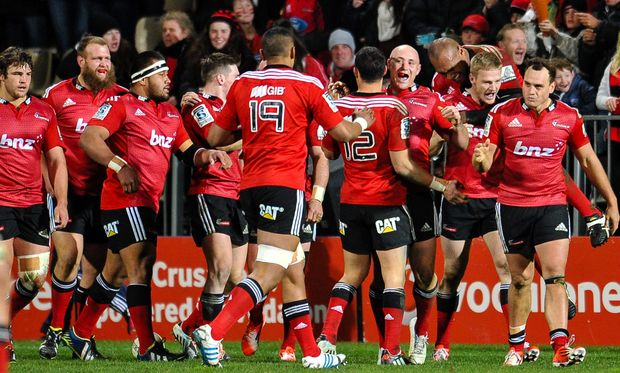 The Crusaders celebrates Johnny McNicholl of the Crusaders try in the Super Rugby Semi Final match, Crusaders v Sharks, Christchurch, July 2014.