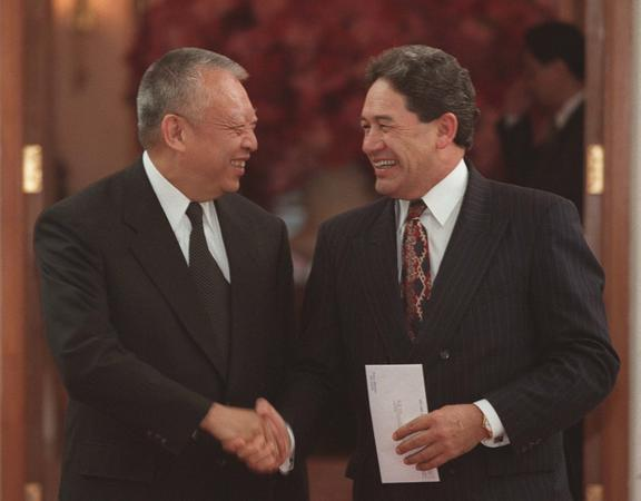 Hong Kong Chief Executive Tung Chee-hwa, left, and former New Zealand Treasurer Winston Peters shake hands during their meeting at the Government House in Hong Kong, a day after the handover on 2 July 1997.