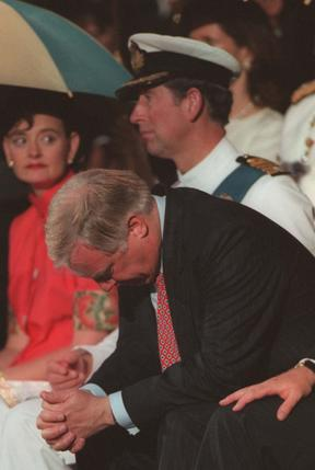 Outgoing Governor of Hong Kong Chris Patten, sitting next to Prince Charles, hangs his head in sadness, after delivering his farewell speech at HMS Tamar in Hong Kong 30 June, 1997.