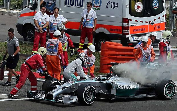 Lewis Hamilton jumps from his burning Mercedes during qualifying in Hungary, 2014.