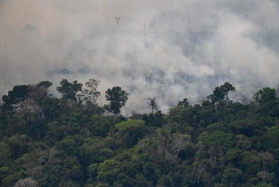 Aerial picture showing smoke from a 2km stretch of fire billowing from the Amazon rainforest, about 65 km from Porto Velho, in northern Brazil, on August 23, 2019.