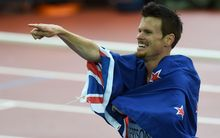 The New Zealand runner Zane Robertson celebrates his bronze medal in the 5000m.