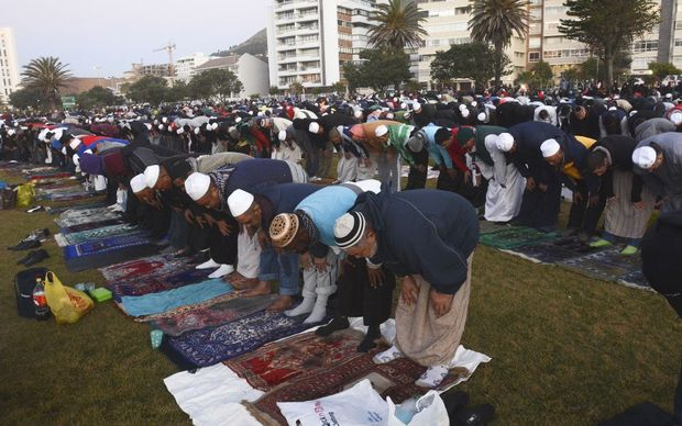 Muslim men pray in Cape Town, South Africa, on Sunday before trying to sight the new moon.