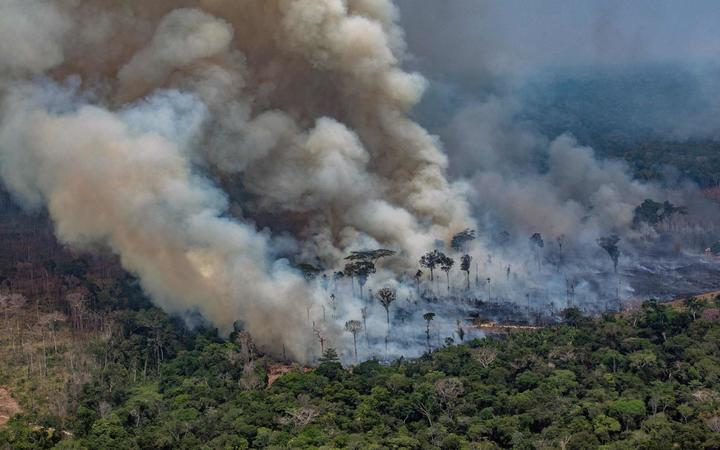 Smoke billowing from forest fires in the municipality of Candeias do Jamari, close to Porto Velho in Rondonia State, Brazil, 24 August 2019.