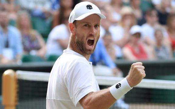 11th July 2019 - Tennis - Wimbledon (Day 10) - Michael Venus (NZL) celebrates as he and his partner Raven Klaasen (RSA) win a point against Juan Sebastian Cabal (COL) and Robert Farah (COL) during their Gentlemen's Doubles Semi Final match - Photo: Simon Stacpoole / Offside.