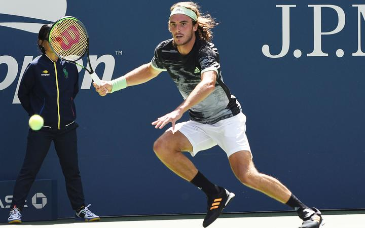FLUSHING MEADOW, NY - AUGUST 27: Stefanos Tsitsipas (GRE) running for a wide forehand during his first round match at the US Open on August 27, 2019, at the Billie Jean King Tennis Center in Flushing Meadow, NY. (Photo by Cynthia Lum/Icon Sportswire) (Photo by Cynthia Lum/Icon Sportswire