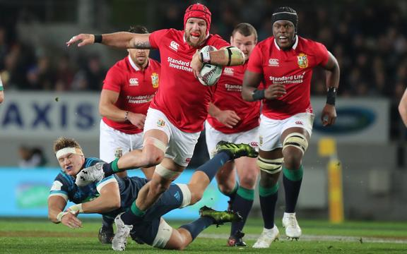 Lions flanker James Haskell breaks the tackle of Blues flanker Blake Gibson during the Blues vs British and Irish Lions match in 2017.