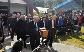 Pallbearers carry Pita Paraone's coffin for burial at his ancestral urupā.