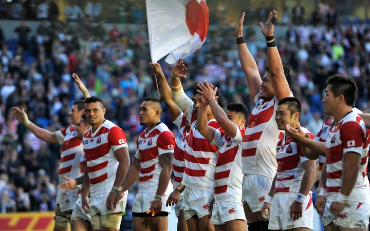 The Japan team celebrate with the crowd after their World Cup pool match win over South Africa at the 2015 tournament.