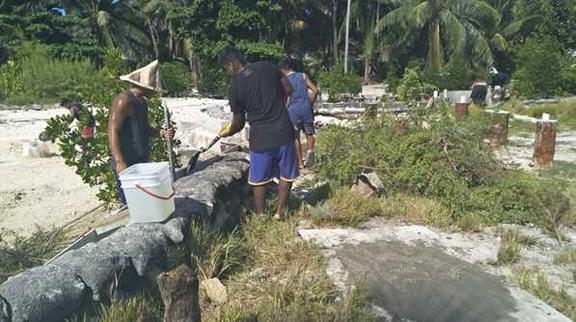 Youths on South Tarawa rebuilding seawalls at low tide, 30 August 2019