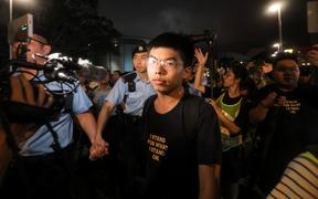 July 7, 2019, pro-democracy activist Joshua Wong confronts police after taking part in a march to the West Kowloon rail terminus against the proposed extradition bill in Hong Kong.