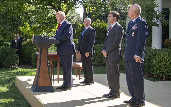 United States President Donald J. Trump, left, makes remarks establishing the US Space Command in the Rose Garden of the White House in Washington, DC on Thursday, August 29, 2019.
