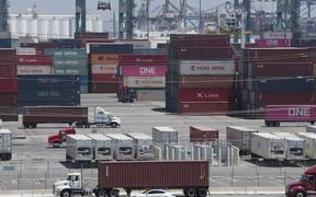 (FILES) In this file photo taken on August 01, 2019 Shipping containers from China and Asia are unloaded at the Long Beach port, California.