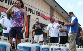 BOYNTON BEACH, FLORIDA - AUGUST 30: People wait in line at a U-Haul store to fill their propane tanks before the possible arrival of Hurricane Dorian on August 30, 2019 in Boynton Beach, Florida.
