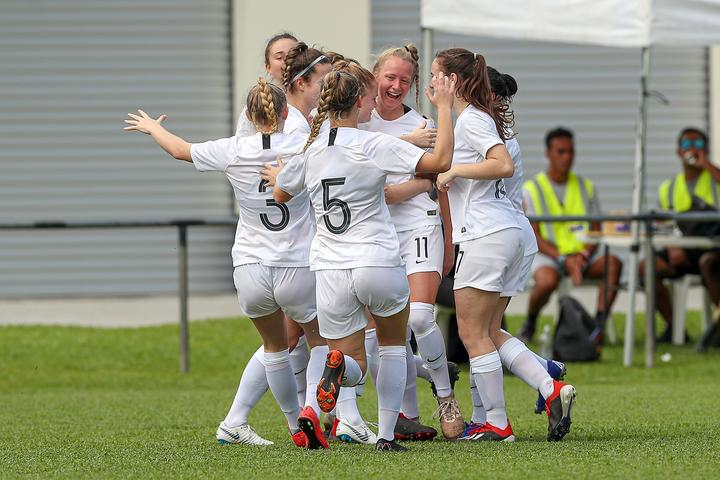 New Zealand's Kelli Brown (facing) celebrates scoring the opening goal of the match.