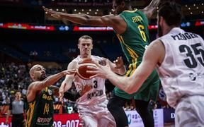 Tall Blacks forward Finn Delany passes the ball to center Alex Pledger during the side's 102-94 loss to Brazil at the Basketball World Cup in China.