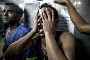 A relative reacts after seeing the bodies of children killed in an explosion in a playground in Gaza in late July.