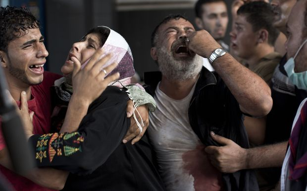 Palestinian mourners cry at Gaza City's al-Shifa hospital after an explosion killed children in a playground in late July.