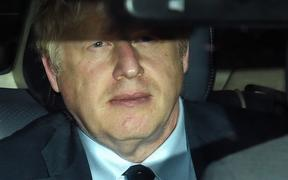 Britain's Prime Minister Boris Johnson is driven away from the Houses of Parliament after suffering a major parliamentary defeat in an emergency debate over his Brexit strategy on Tuesday.